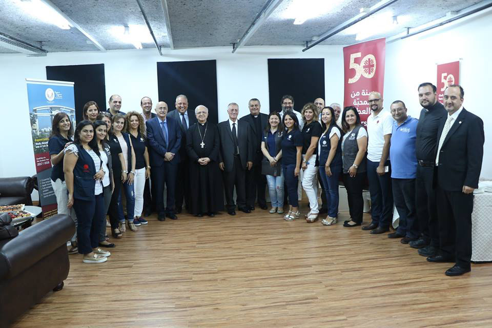 AUM and Caritas sign MoU