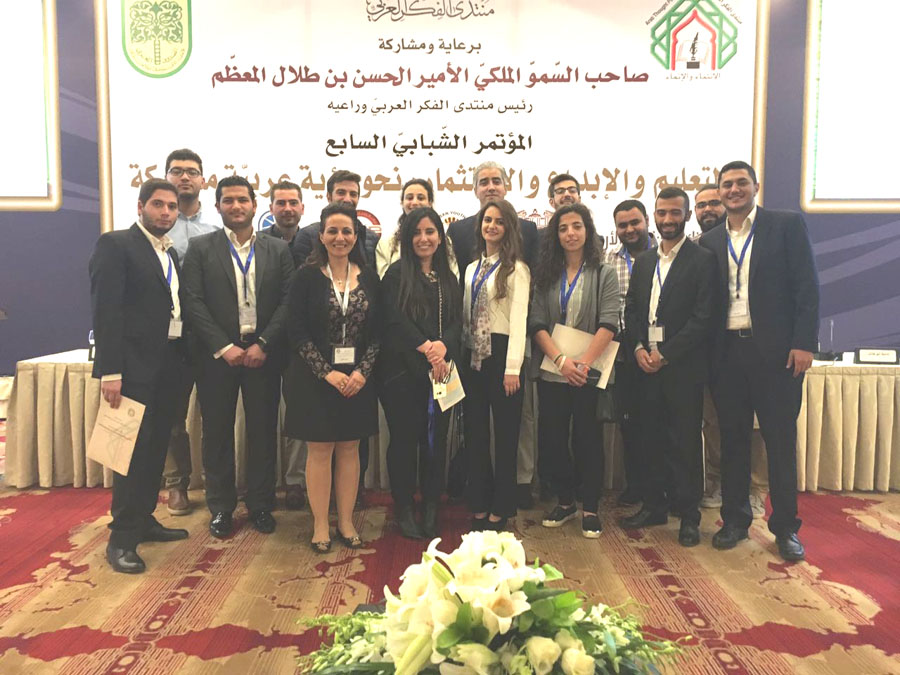 Group of AUM's professors and students attending conference